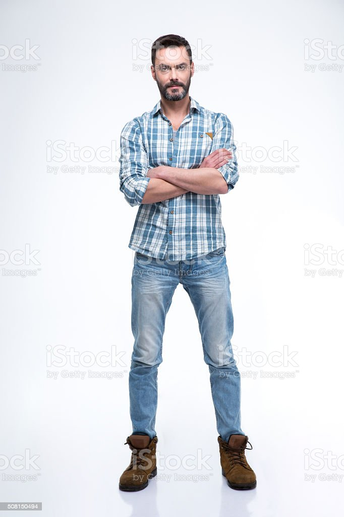 Full length portrait of a serious man in casual cloth stock photo