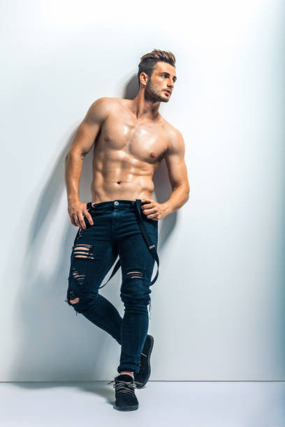 full length portrait of a sexy muscular shirtless man - a petto nudo foto e immagini stock