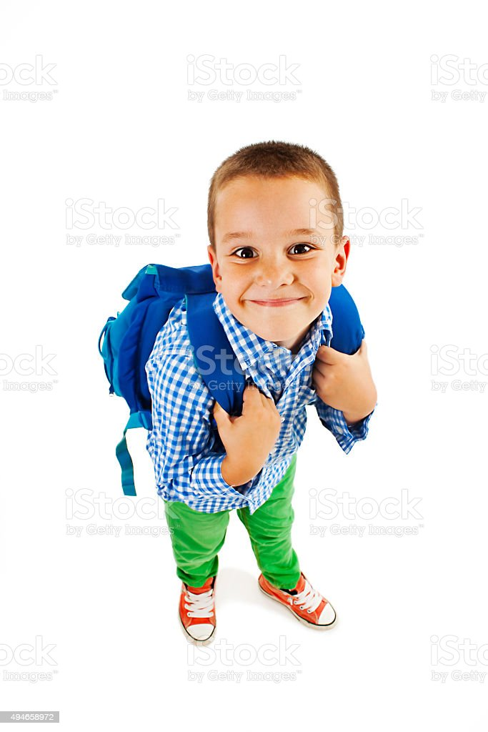 Full length portrait of a smiling school boy with backpack stock photo