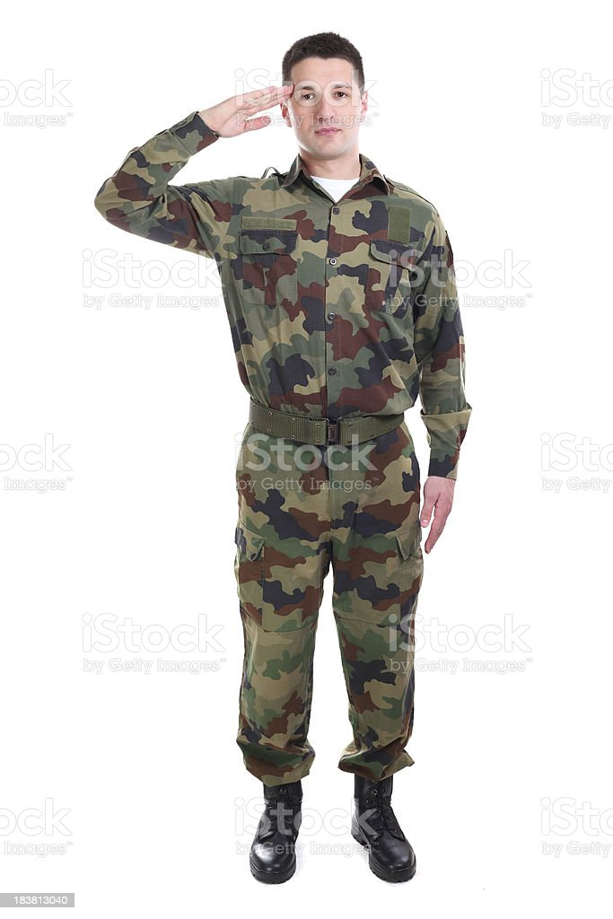 Full length portrait of a soldier saluting royalty-free stock photo