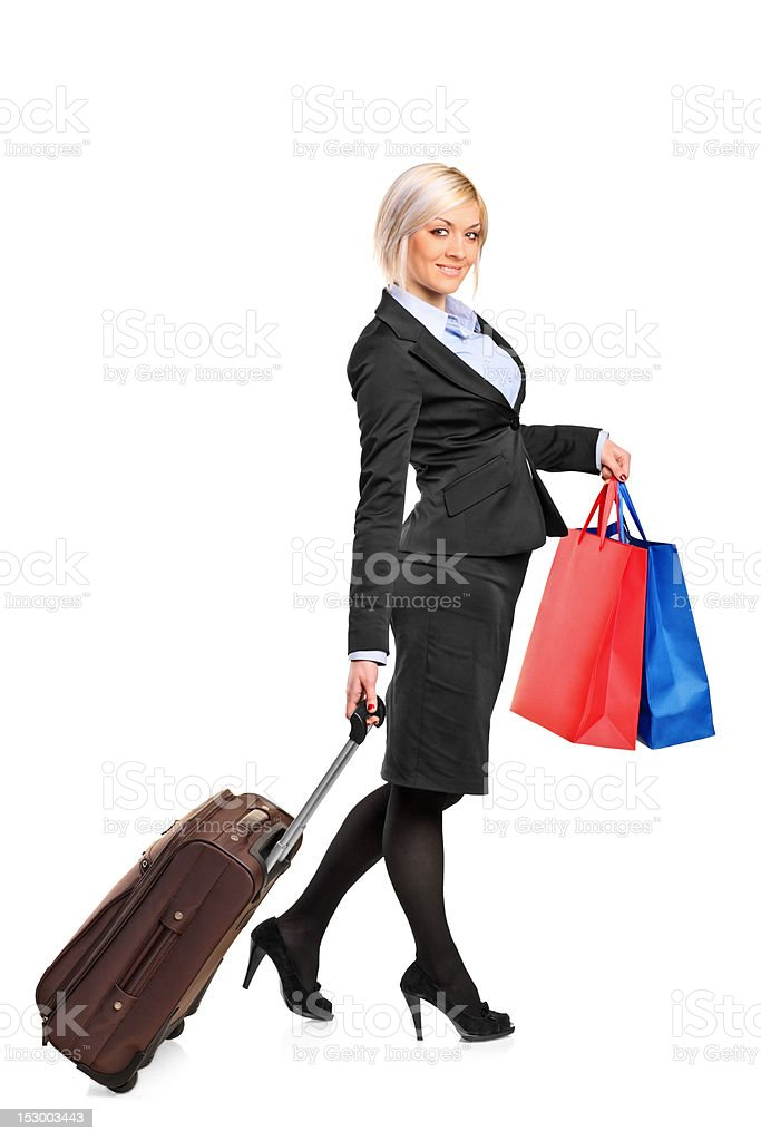 Full length portrait of a woman carrying suitcase royalty-free stock photo