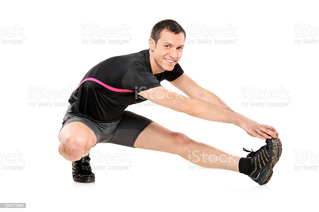Full length portrait of a young athlete exercising royalty-free stock photo