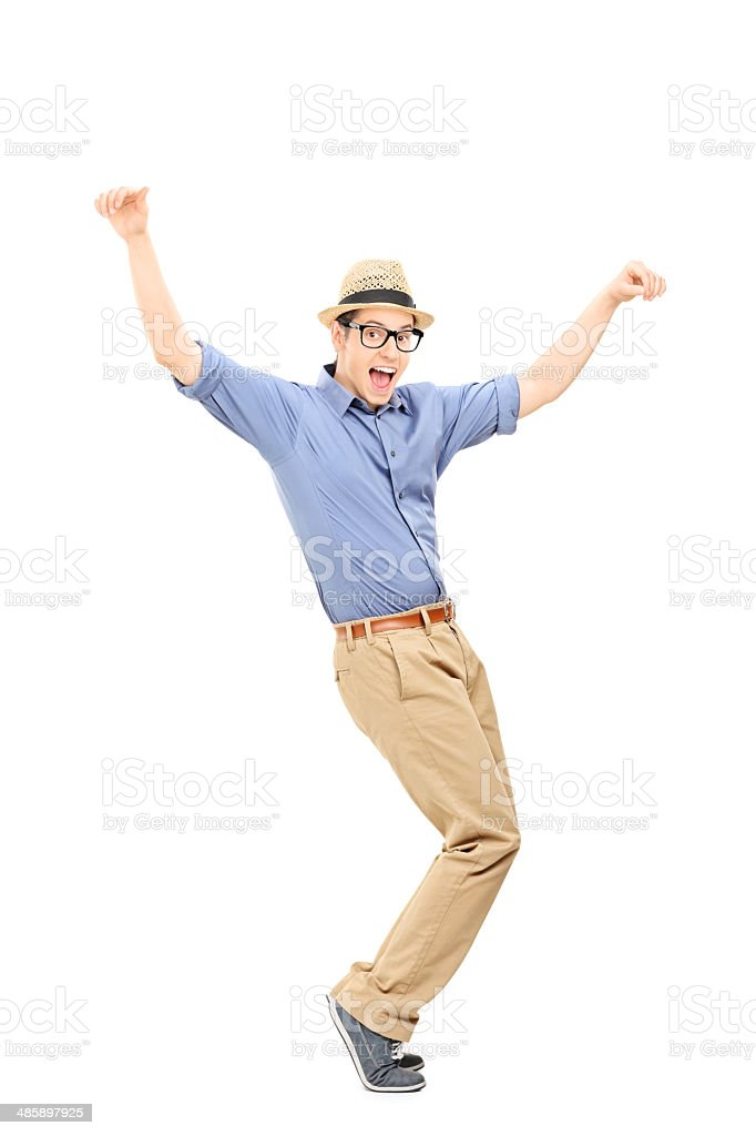 Full length portrait of an excited man dancing stock photo
