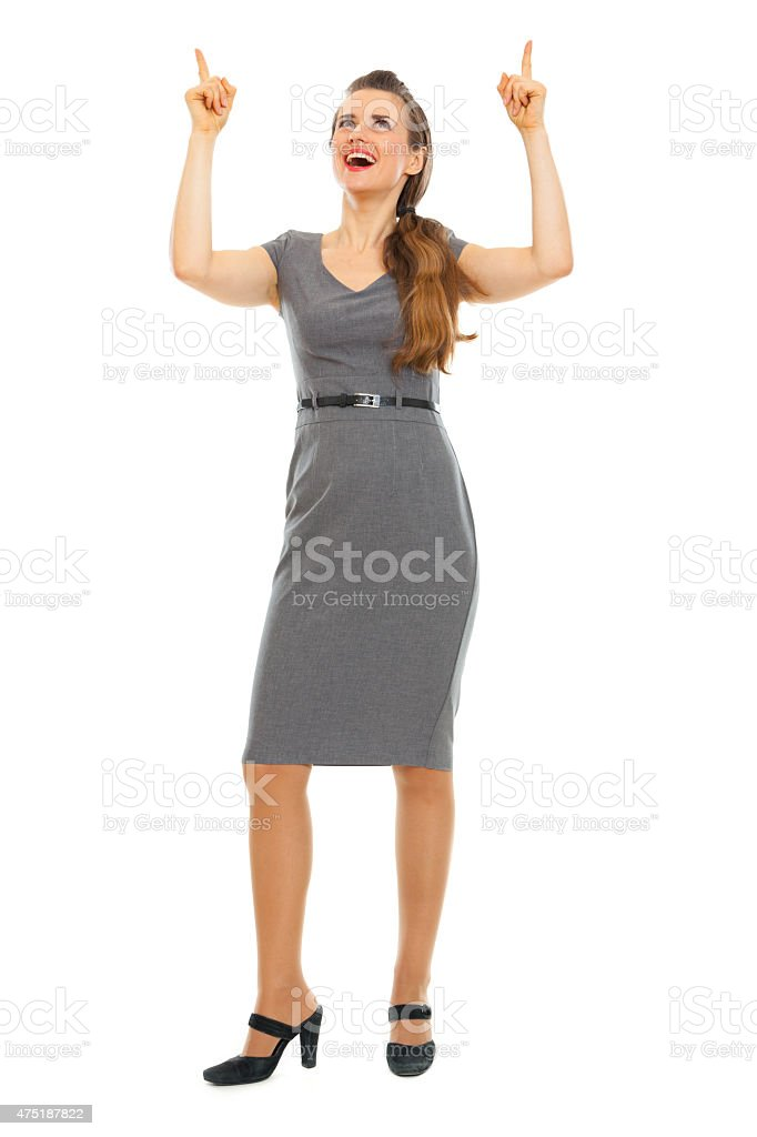 full length portrait of business woman pointing up stock photo