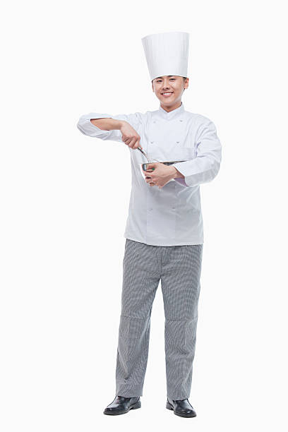 Full Length Portrait of Chef with Whisk Full Length Portrait of Chef with Whisk chef's whites stock pictures, royalty-free photos & images
