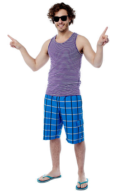 Full length portrait of cool young guy stock photo