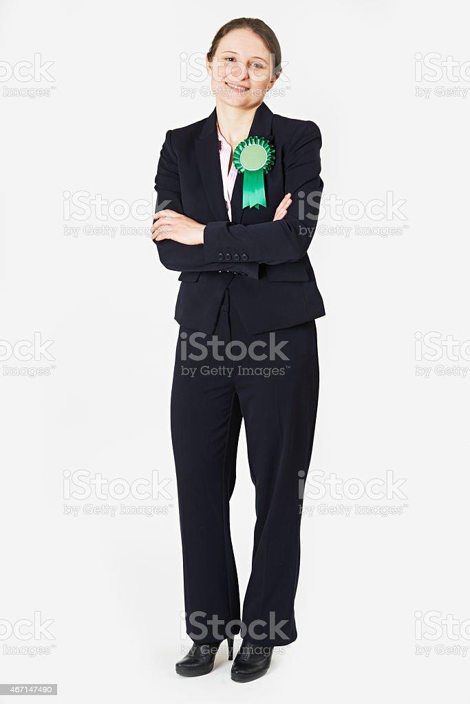 Full Length Portrait Of Female Politician Wearing Green Rosette stock photo