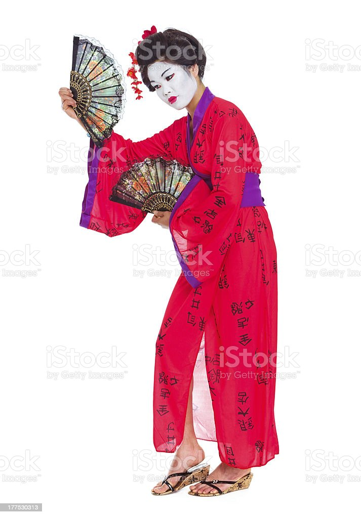 Full length portrait of geisha dancing with fans stock photo