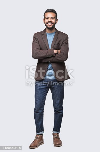 Cheerful young men studio shot. Isolated on gray background