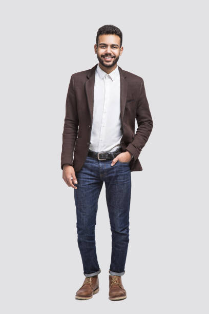 Full length portrait of handsome smiling young man stock photo