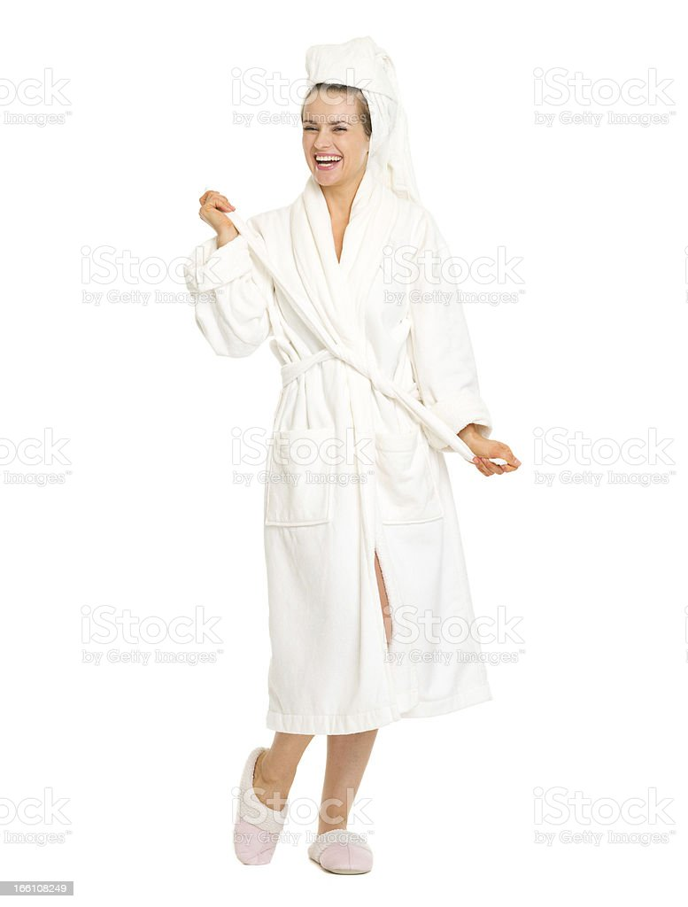 Full length portrait of happy young woman in bathrobe royalty-free stock photo