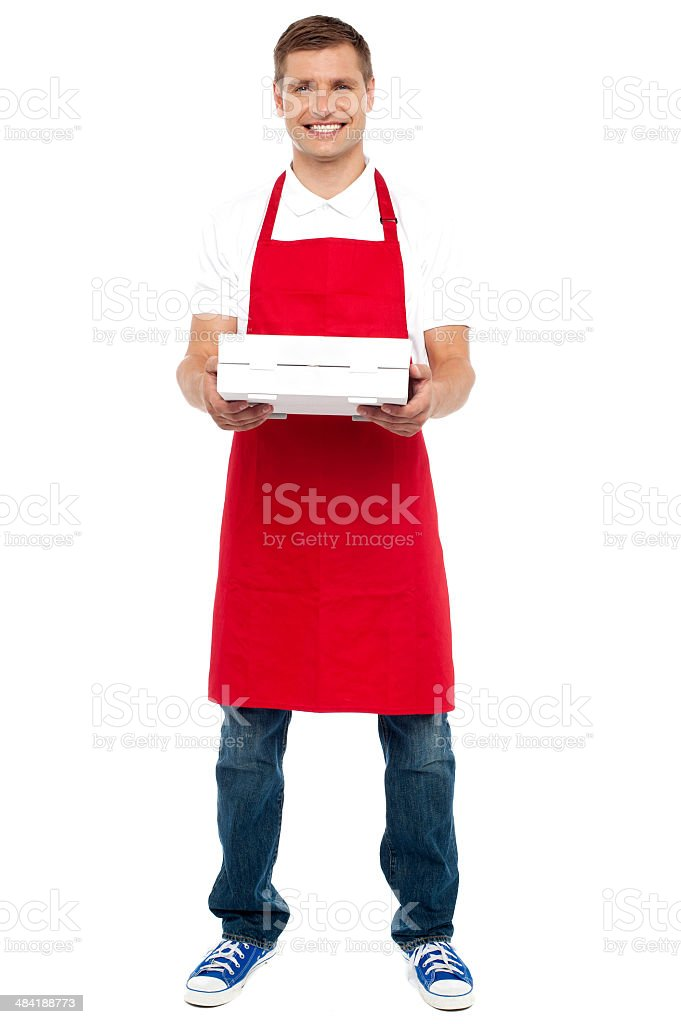 Full length portrait of male chef holding pie box stock photo