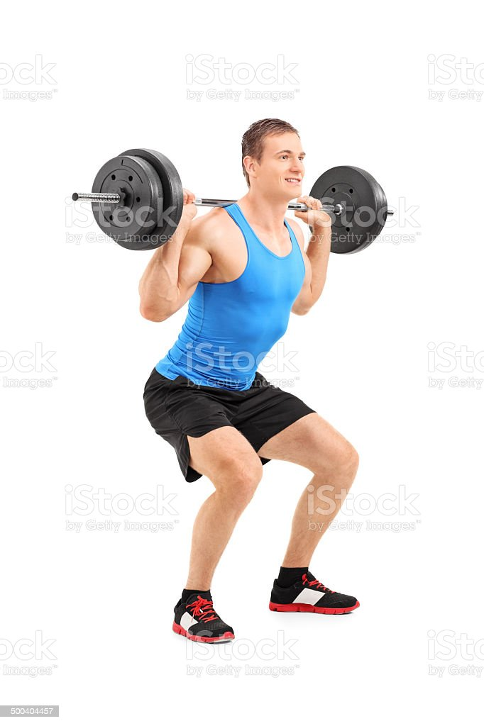 Full length portrait of man lifting heavy weight royalty-free stock photo