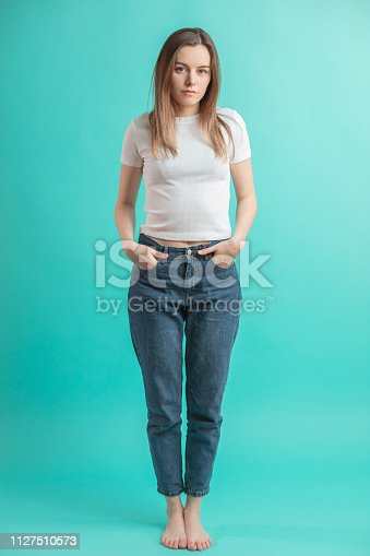1126620182istockphoto full length portrait of nice street girl in casual outfit 1127510573