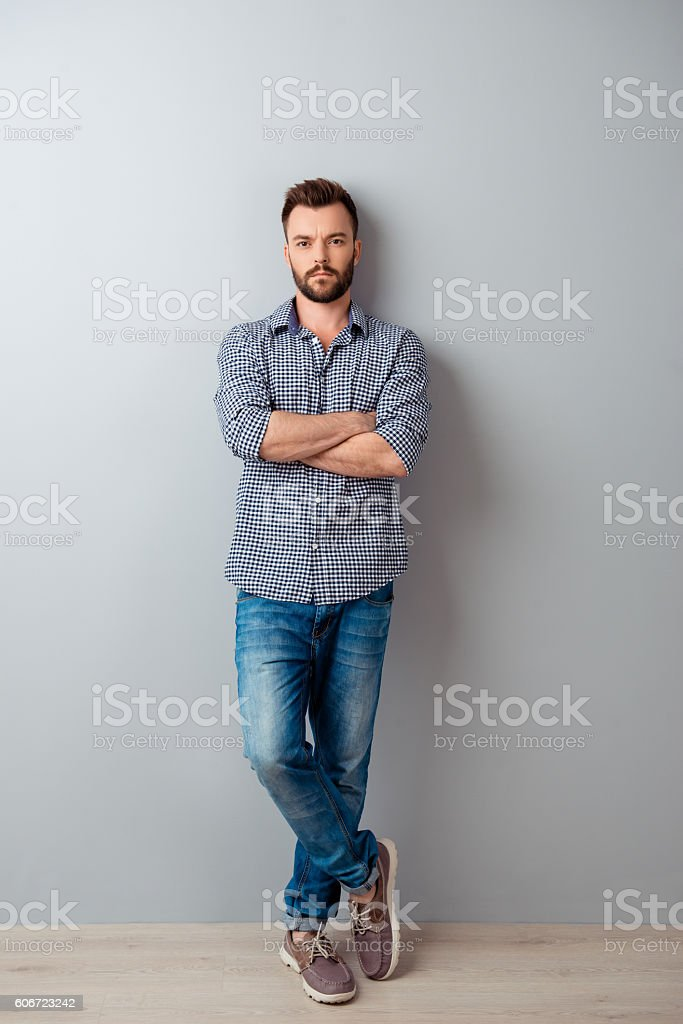 Full length portrait of  serious businessman with crossed hands stock photo