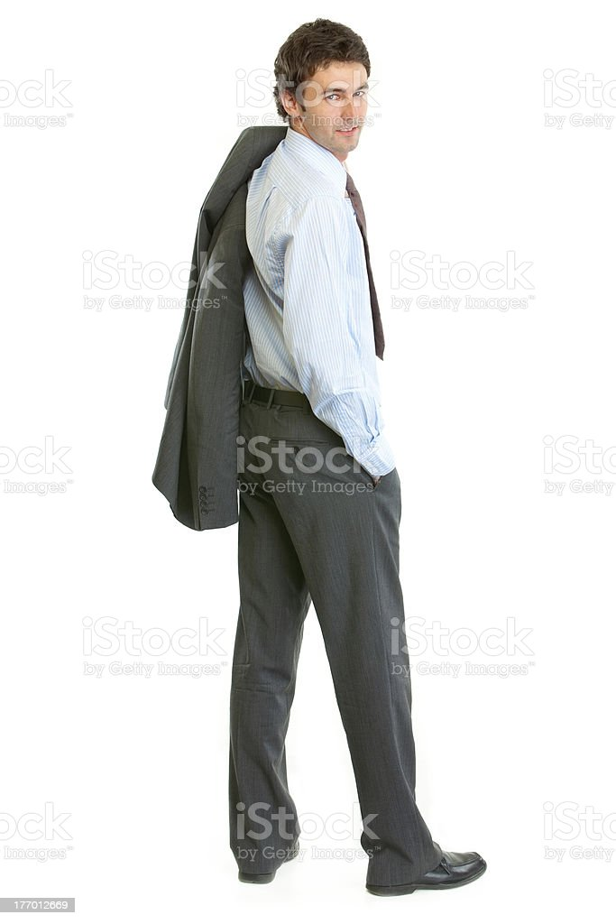 Full length portrait of smiling modern businessman looking back royalty-free stock photo