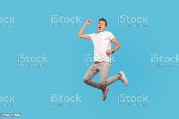 Full length portrait of successful overjoyed man in white tshirt and picture id1204987637?b=1&k=6&m=1204987637&s=612x612&h=xwhhfwdbm u7l1pu7xsjkxnpjbkddnijmsgbhvpoylc=