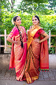 istock Full length portrait of two Indian brides 1181123791