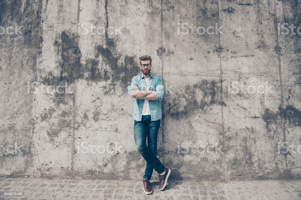 Full length portrait of young red bearded man in stylish casual...