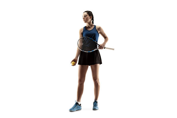 full length portrait of young woman playing tennis isolated on white background - theatre full of people stage foto e immagini stock