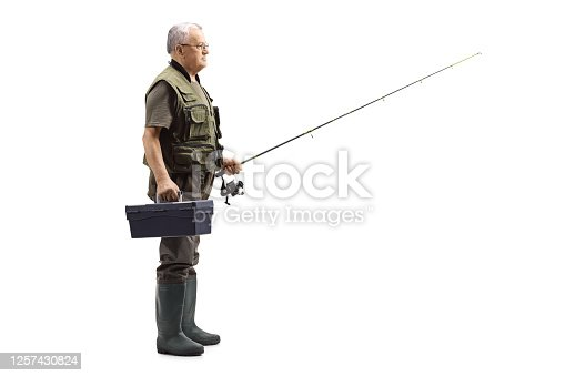 istock Full length profile shot of an elderly fisherman with a box and fishing rod 1257430824