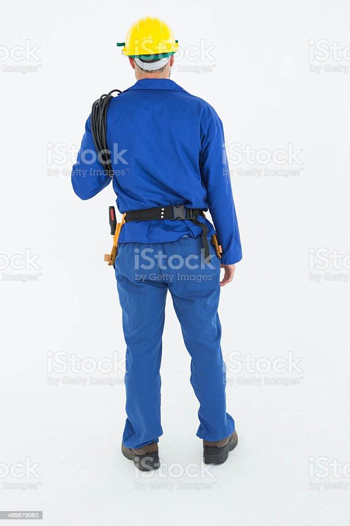Full length rear view of repairman stock photo