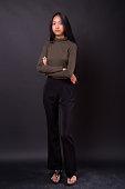 Studio Shot Of Beautiful Asian Woman Against Black Background