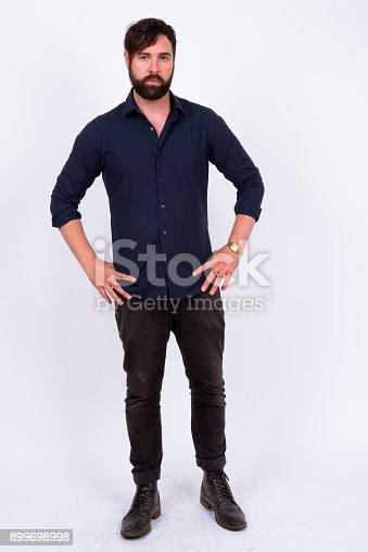 931173966istockphoto Full Length Shot Of Handsome Bearded Man With Blue Eyes And Tattoos Standing Against White Background 899698998