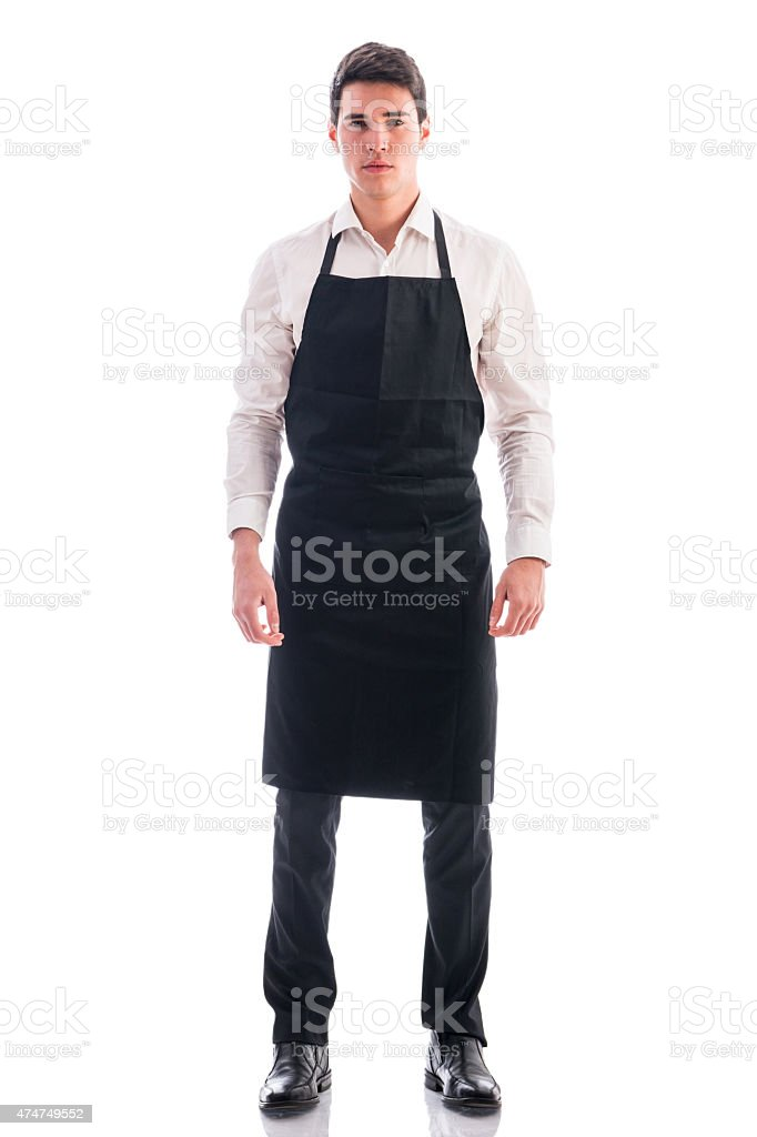 Full length shot of young chef or waiter posing isolated stock photo