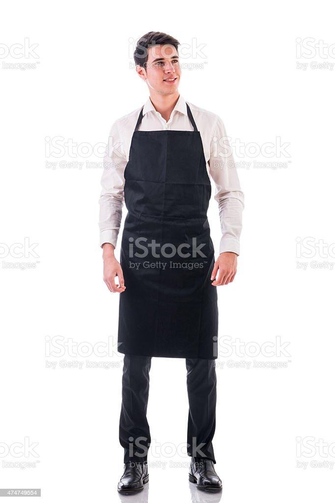 Полная длина фото Молодой шеф-повар Официант, которые позируют изолированные или стоковое фото