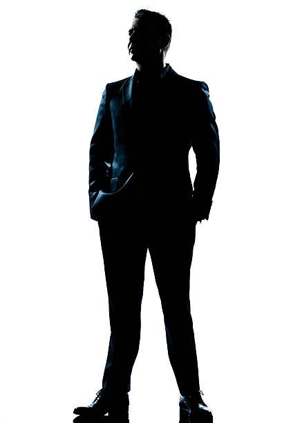 durchgehende silhouette der geschäftsmann im anzug - gegenlicht stock-fotos und bilder