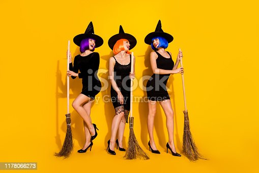 512061362 istock photo Full length size body photo of three gorgeous beautiful careless excited ladies holding using broomstick in hands having fascinating look isolated bright color background 1178066273