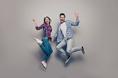 Full length size photo studio of she her his he glad free time enjoying nice cool students make give v-sign holding hands in jeans denim clothes isolated grey background