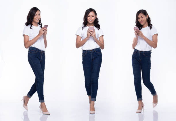 full length snap figure, asian woman wear casual white shirt blue jean, she 20s walks in many poses direction while chit chat on smartphone, studio lighting white background isolated collage group - ritratto 360 gradi foto e immagini stock