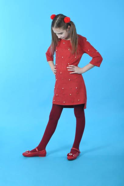 0cd1205fe0b Full length studio photo girl wearing red dress standing stock photo