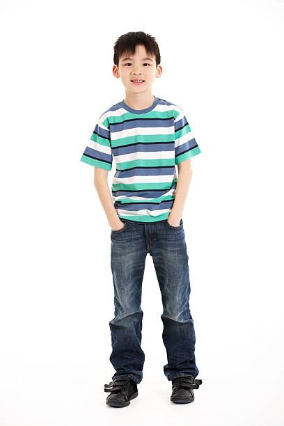 Full Length Studio Shot Of Chinese Boy stock photo