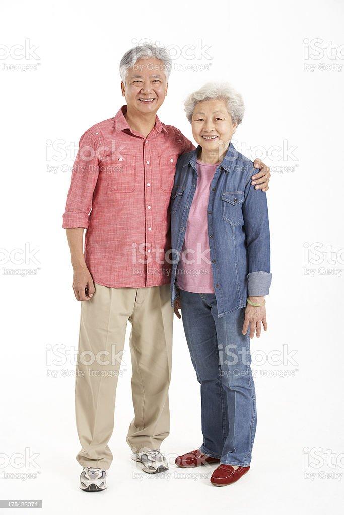 Full Length Studio Shot Of Chinese Senior Couple stock photo