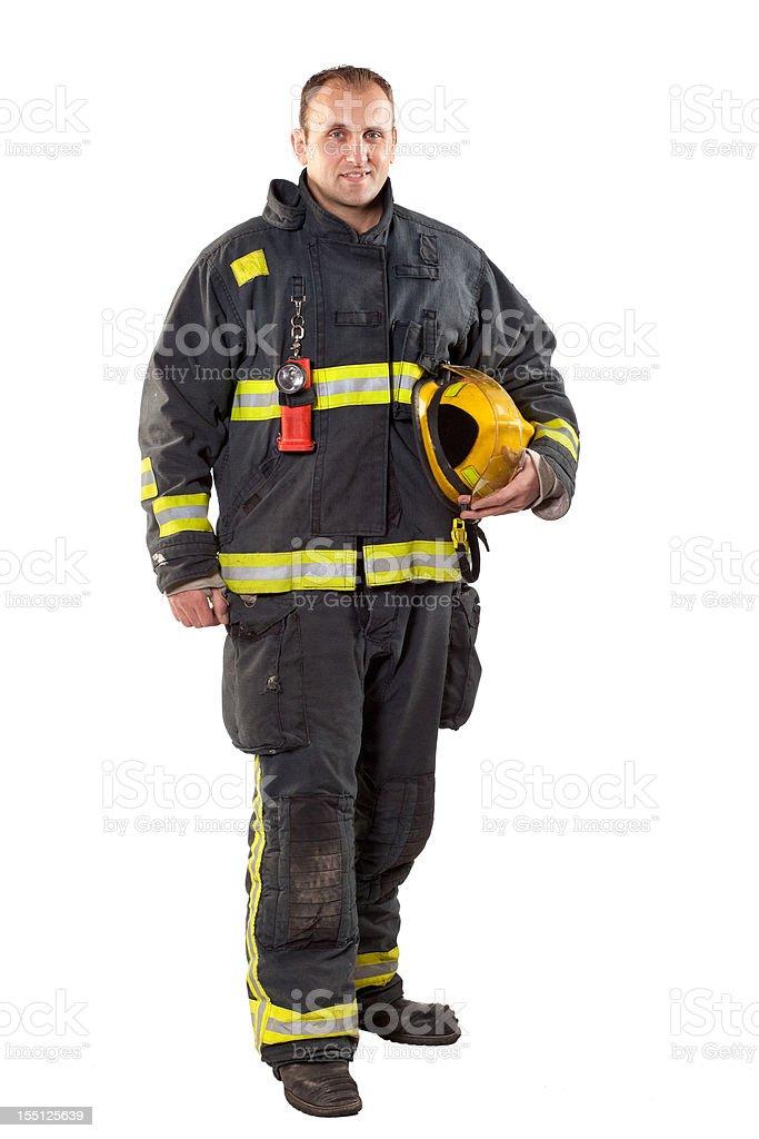 Full length studio shot of fireman on white background royalty-free stock photo
