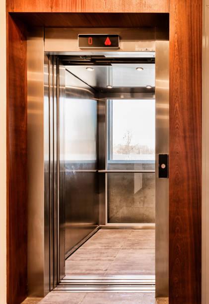Full length view of elevator in condominium stock photo