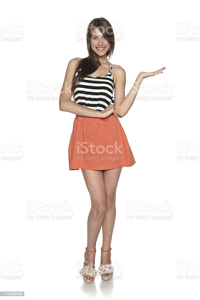 Full length woman showing blank copy space stock photo