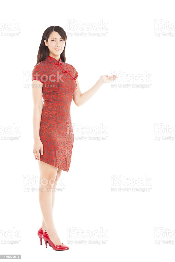 full length young asian woman showing something royalty-free stock photo