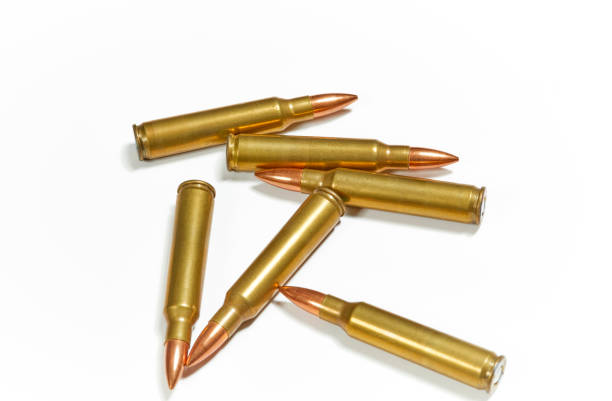 Full Metal Jacket Ammunition AR 15 full metal jacket ammunition isolated on white ammunition stock pictures, royalty-free photos & images