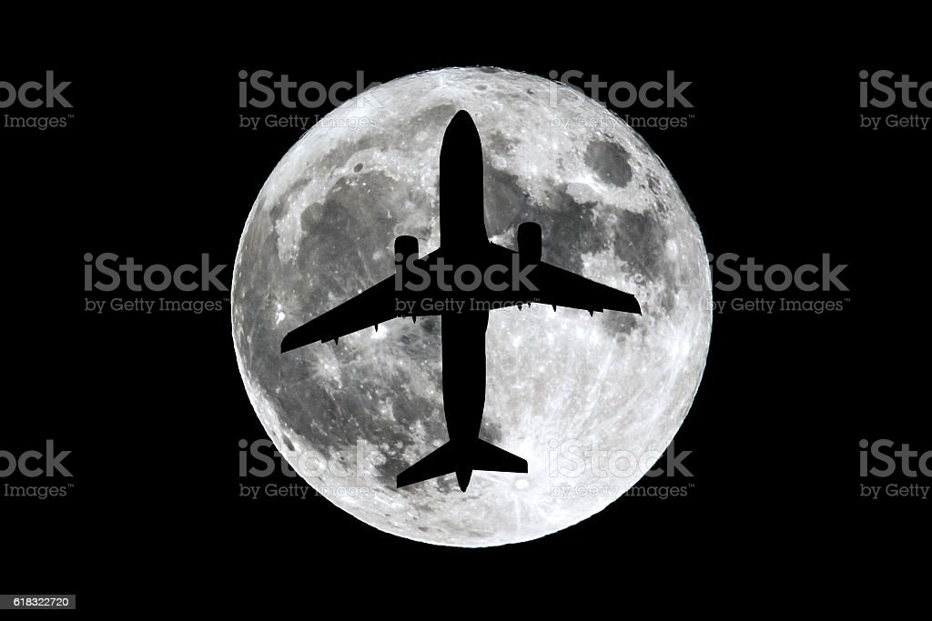 Full Moon airplane silhouette stock photo