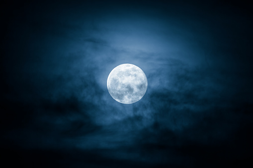 Full Moon and clouds on the night sky
