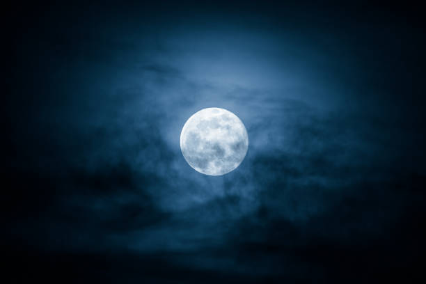 full moon and clouds on the night sky - moon stock pictures, royalty-free photos & images