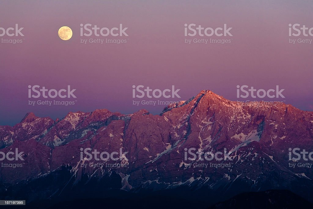 full moon at mt. zugspitze royalty-free stock photo