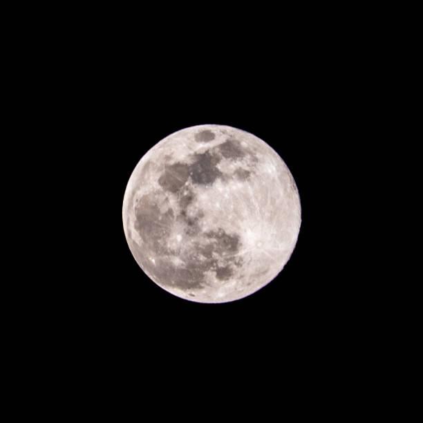 Full moon at night stock photo