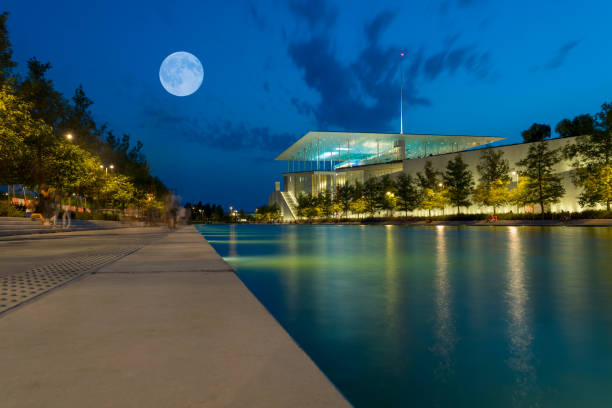 Full moon at Stavros Niarchos building. stock photo