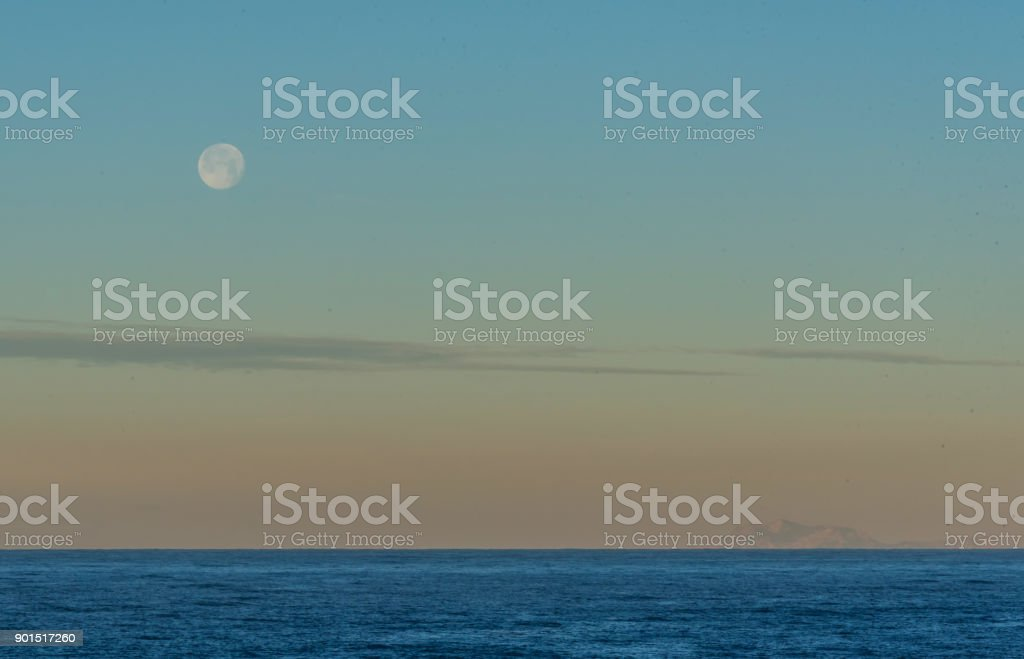 Full Moon at Sunrise over the Mediterranean Sea