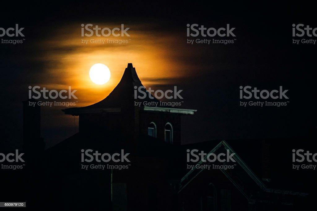 Full moon behind abandoned building. Detroit, MI. stock photo